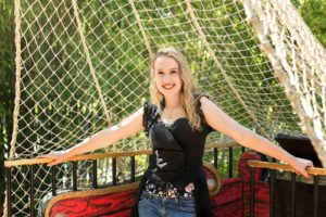 senior girl on a pirate ship in fairytale town