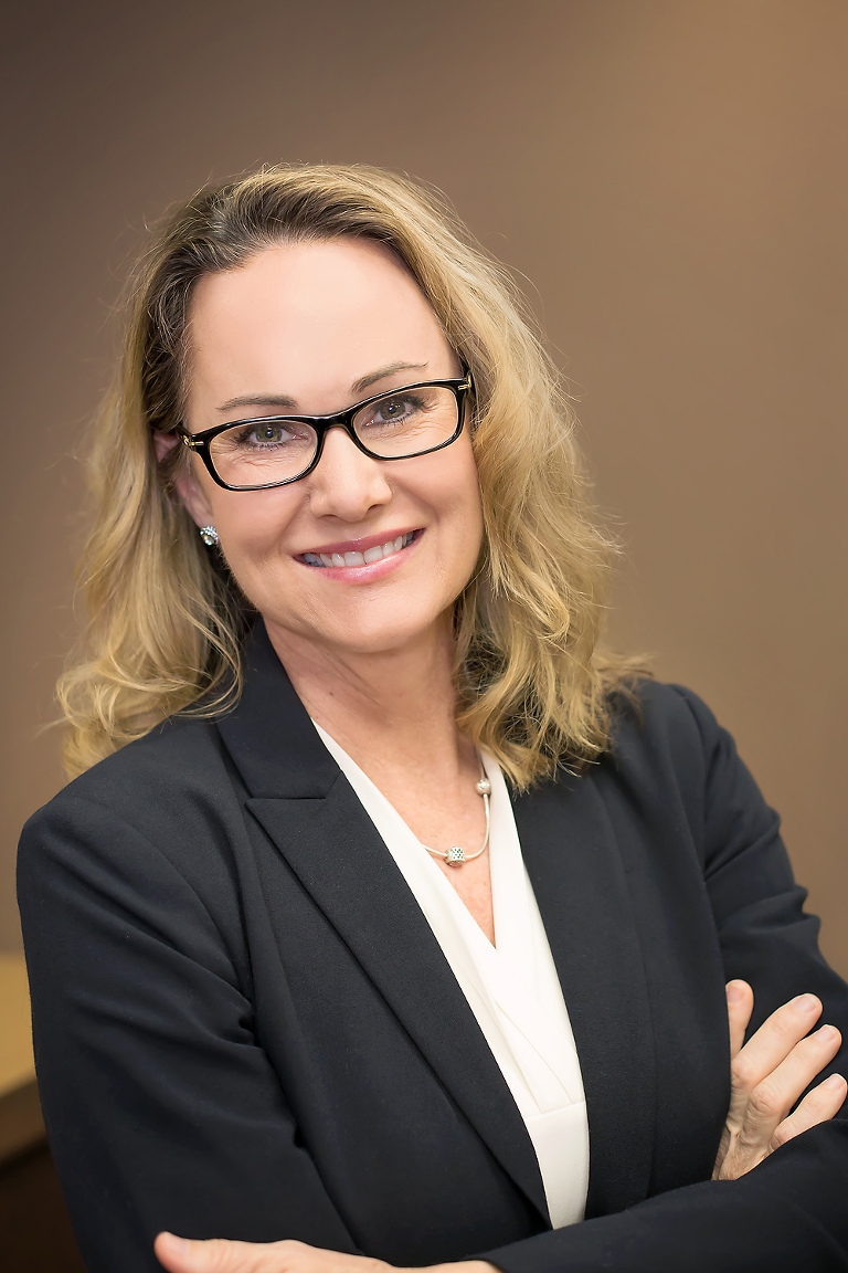 professional headshot of a woman in her office
